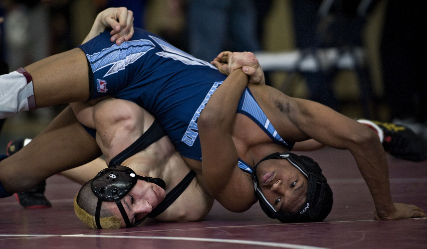 Warren County's Wyatt Gill and Lakeland's Dajun Jacobs are tied up during their 152-pound bout during the 3A East Wrestling tournament Friday afternoon at Skyline High School. Gill won the match by a pin. Rich Cooley/Daily